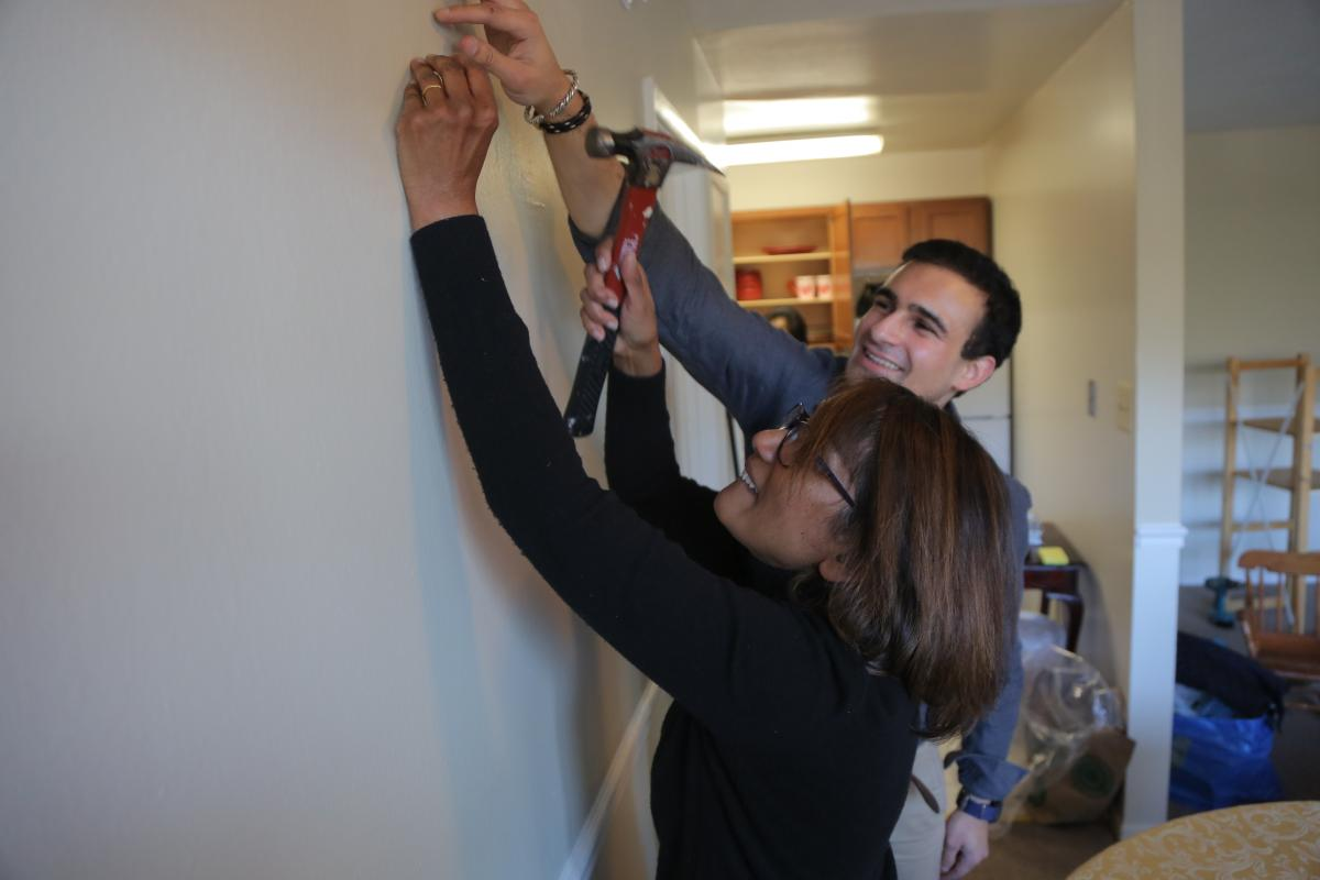 Hannah Koilpillai and Nicholas Grossman, who both attend Sligo church, help prepare a home for a family from Afghanistan.
