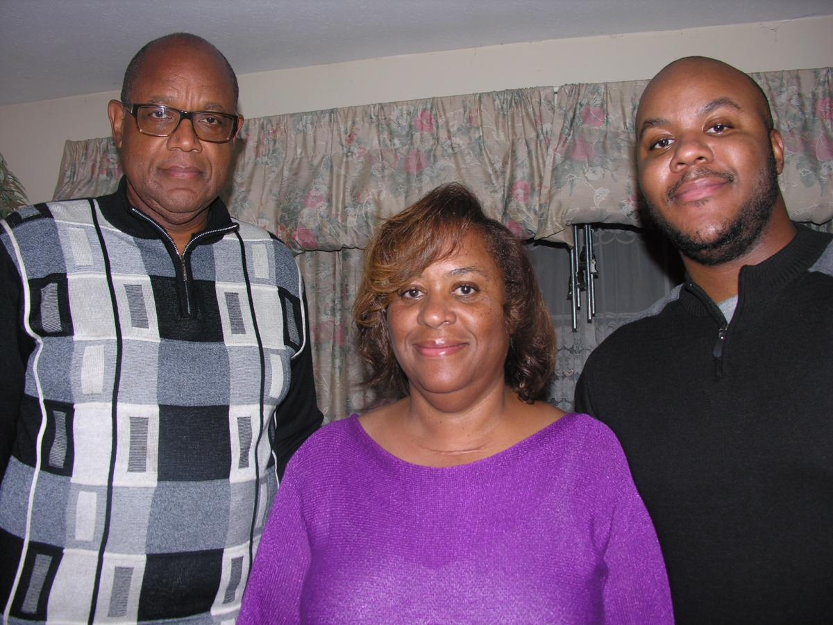 Cindy Washington is pictured with her husband, Kenneth, a pastor, and their son, Kendrick.