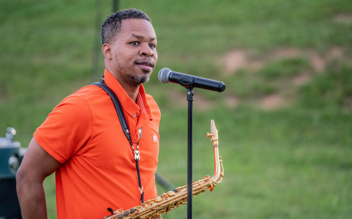 Leighton Kennedy, a member of Emmanuel-Brinklow church prepares to play a song during the Community Prayer Vigil.