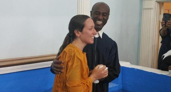 Enock Bouzy, lay pastor of the Collingwood Park church, baptizes a woman during the fall evangelism initiative.