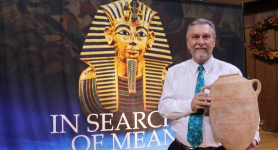 Pastor Franke Zollman displays an artifact.