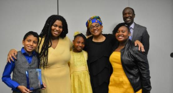 Maxine Forbes-Goulding and her former and current students and Sadrail Saint-Ulysse celebrate Forbes-Goulding's recent honor.
