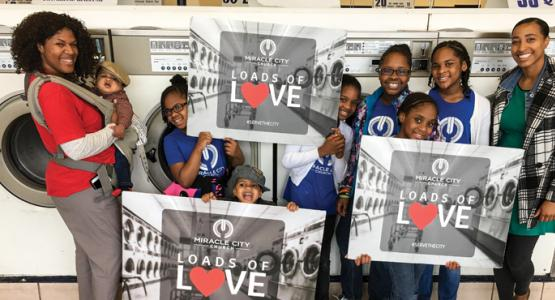 "Members of Allegheny East Conference's Miracle City church in Baltimore provide ""Loads of Love"" (free laundry) to members of the community."