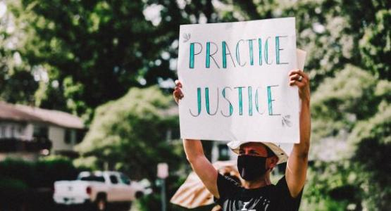 Pastor Munoz, associate pastor at Seabrook church, participates in a march for racial justice. Photo by Peter A. Roberts