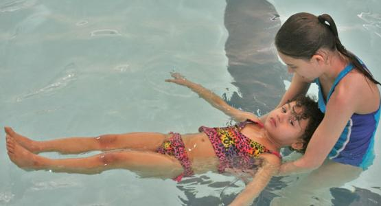 Kristiana Hoffman instructs one of her students during a swim class. Photo by Laura Hoffman