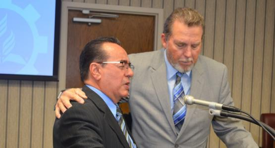 José H. Cortés Sr. and Dave Weigley pray together during a Columbia Union Conference Executive Committee meeting.