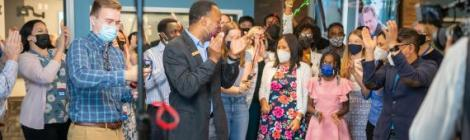 WGTS listeners and staff cheer as the new station goes live.