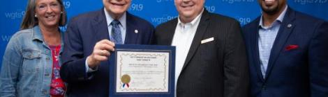 "Mayor Bridget Newton (left), and councilmembers Sidney Katz and Will Jawando (right), declare August 23, 2019, ""WGTS 91.9 Day,"" awarded to President and General Manager Kevin Krueger (second from right)."