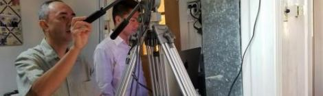 Arthur Admana teaches JD Hernandez how to lead a live production during a Sabbath service.