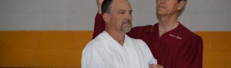 At this year's Pennyslvania Camp Meeting, Mark Dekle, pastor of the Walnutport church, baptizes Doug Seipt.