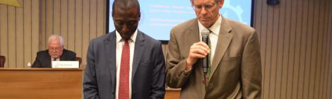 Michael Jamieson, NAD undertreasurer, prays for Emmanuel Asiedu. Photo by Ricardo Bacchus