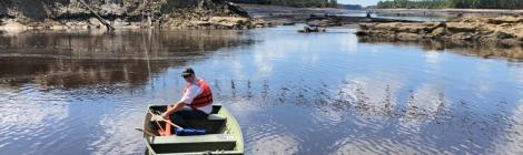 Tracy Hendren, Savannah District Engineering Division Chief, traverses the water to inspect the washout of Boiling Springs Dam, N.C. Sept. 19 after Hurricane Florence. The object stretching across the divide is the guard rail of the road that once passed over the dam. (U.S. Army Corps of Engineers photo)