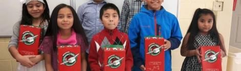 Members from Chesapeake Conference's Iglesia Adventista Hispana Laurel (Md.). fill shoeboxes for kids around the world through Compassion International's Operation Christmas Child.