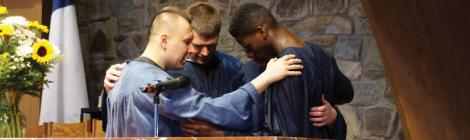 Justin Montero and Spencerville youth pastor Stephen Finney pray with Jacob Harris at Harris' baptism. Photo credit: Juliana Baioni