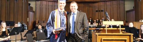 Zachary Macomber and Darren Wilkins, Spring Valley Academy principal, after graduation