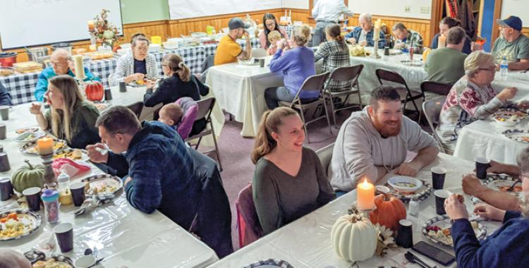 Mountaintop and community members fellowship together over a Thanksgiving meal.