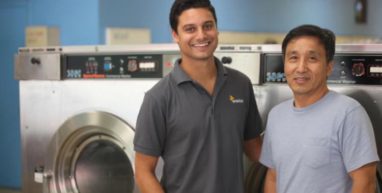 Ross Patterson photographed Enactus member Levi Soares and owner Nok Kim in the Rainbow Coin Laundry in Silver Spring, Md.,