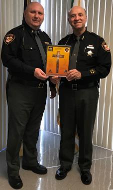 Marius E. Marton (left) presents Lorain County Sheriff Phil R. Stammitti with a certificate of appreciation.