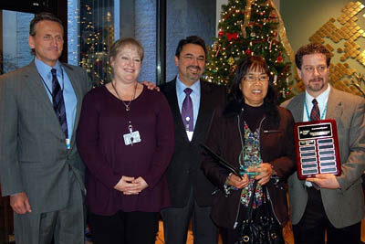 Hospital administrators present Ester Bacud (second from right) her Compassionate Care Award.