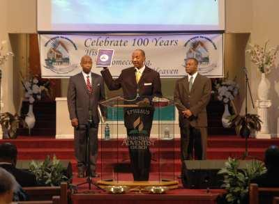 Donald Burden (center), Ephesus pastor, leads the anniversary celebration on Sabbath morning.
