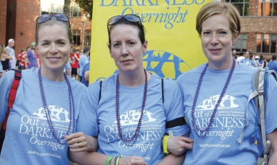 The author (center) relied on friends Kristen Pangborn (left) and Lisa Wolfe to support her through the emotional walk..