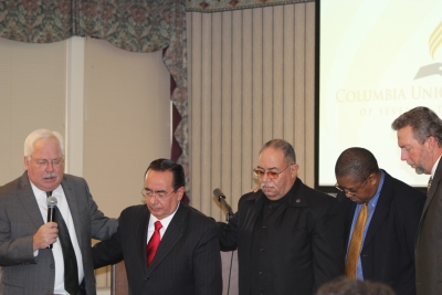Pictured in prayer are (left to right) Rob Vandeman, union executive secretary; José H. Cortés, New Jersey Conference president; Henry J. Fordham, Allegheny East Conference president; Seth Bardu, union treasurer; and Dave Weigley, union president.