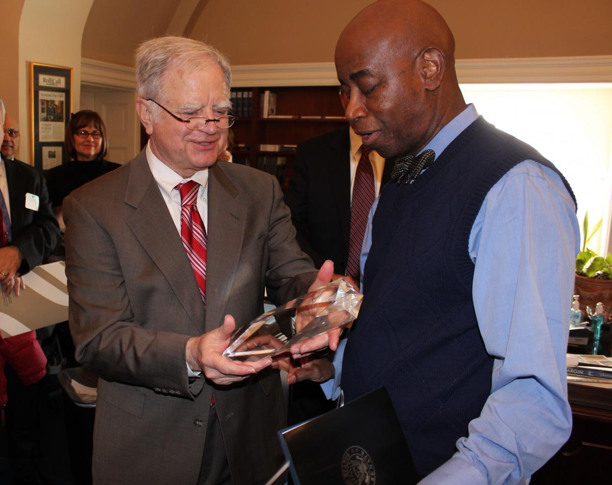 Carson is pictured presenting an award to U.S. Senate Chaplain Barry Black in 2014.