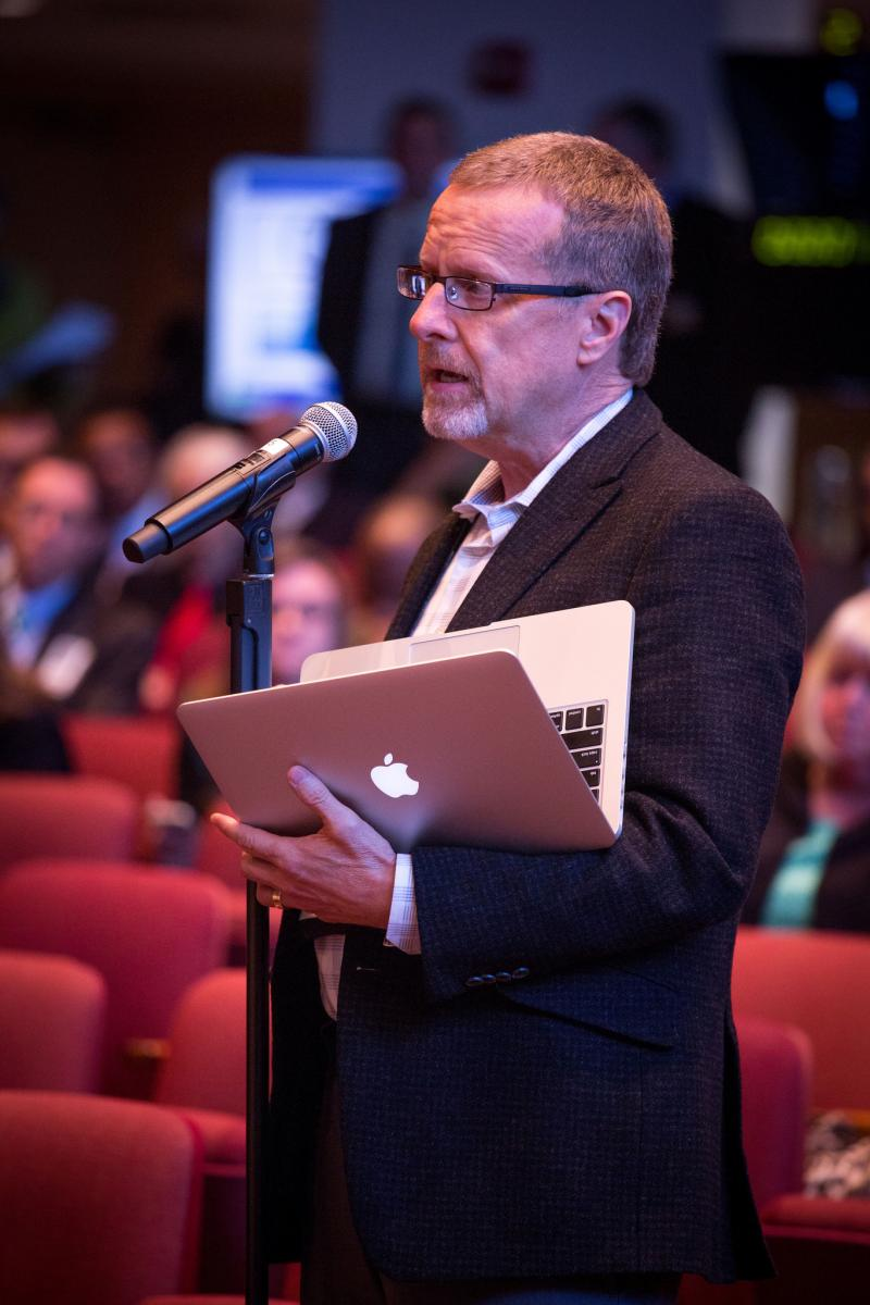 Randy Roberts, senior pastor of the Loma Linda University Seventh-day Adventist Church, reads the motion that was voted during the second half of the discussion on Oct. 31. Photo by Dan Weber